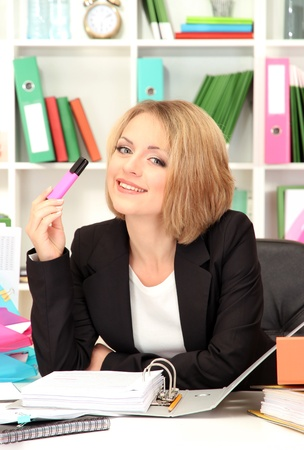 Beautiful young business woman working in office Stock Photo - 21537872