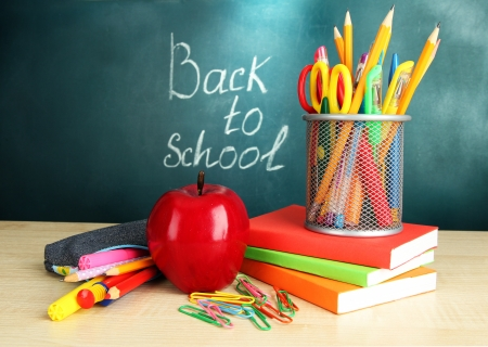 Back to school - blackboard with pencil-box and school equipment on table Stock Photo - 17526111