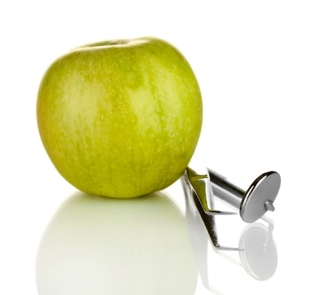 Green apple and dental tools isolated on white Stock Photo - 17518700