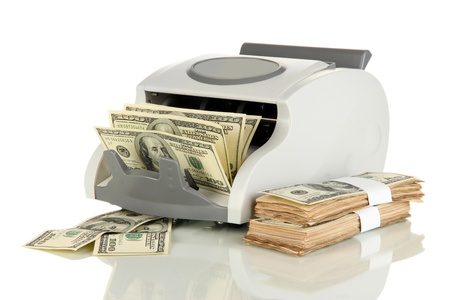 Machine for counting money and 100 dollar bills isolated on white Stock Photo - 17525906