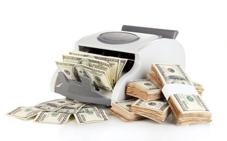 Machine for counting money and 100 dollar bills isolated on white photo