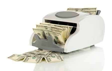 Machine for counting money and 100 dollar bills isolated on white Stock Photo - 17525847