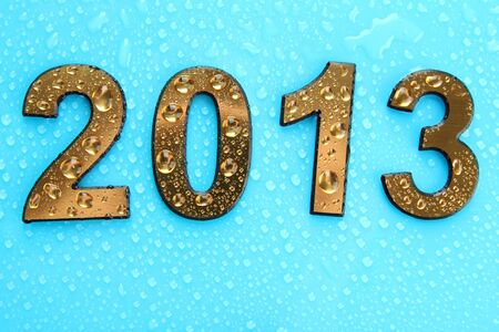 2013 in golden numbers, on blue background photo