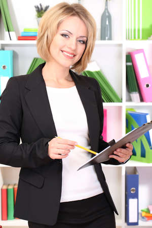 Beautiful young business woman working in office Stock Photo - 21537907