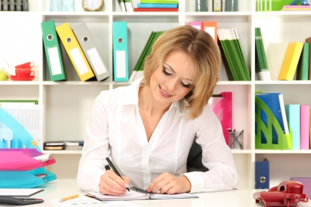 Beautiful young business woman working in office Stock Photo - 21537909