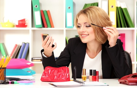 Beautiful young business woman smarten in office Stock Photo - 21537911