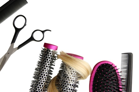 Comb brushes, hair and cutting shears, isolated on white photo