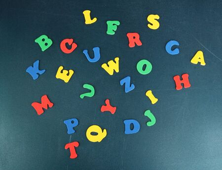 Colorful letters on school board close-up photo