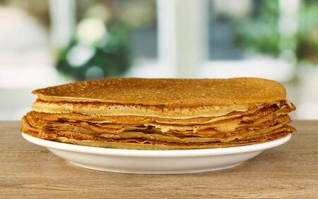 rubicund: Sweet pancakes on plate on table in kitchen