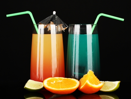 Two cocktails isolated on black photo