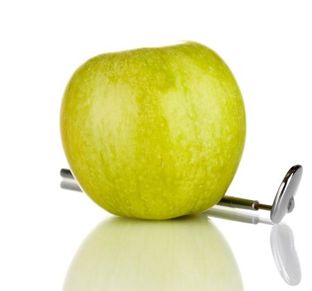 Green apple and dental tool isolated on white Stock Photo - 17526200