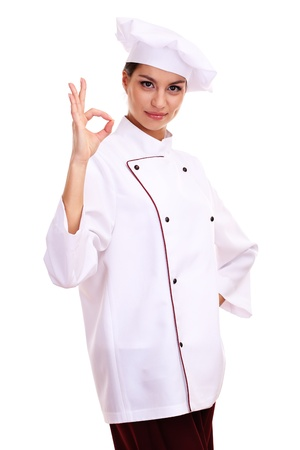 culinary skills: Portrait of young woman chef isolated on white Stock Photo