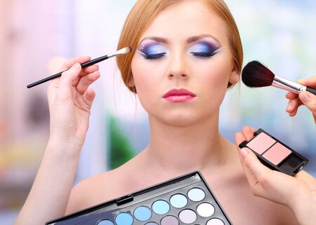 Portrait of beautiful young woman with making makeup in beauty salon photo
