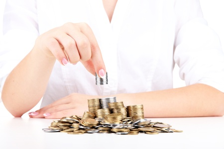 Woman hands with coins, close up Stock Photo - 17548173
