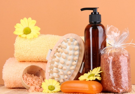 Set for care of a body on peach background Stock Photo - 17548318