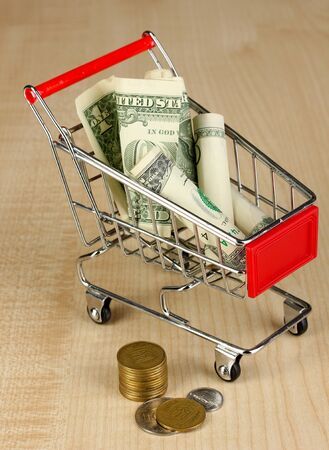 Money in cart on wooden table close-up Stock Photo - 17548451