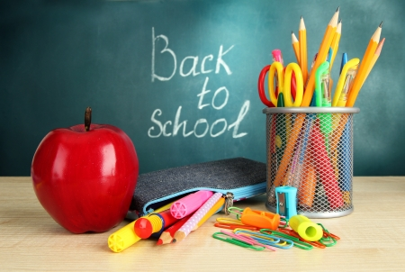 Back to school - blackboard with pencil-box and school equipment on table Stock Photo - 17548381