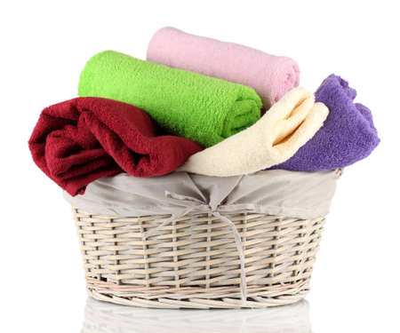 Colorful towels in basket isolated on white Stock Photo - 17529291