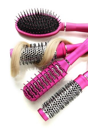 Comb brushes with hair, isolated on white Stock Photo - 17529296