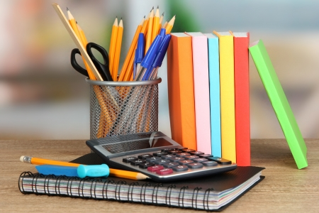 School supplies on wooden table photo