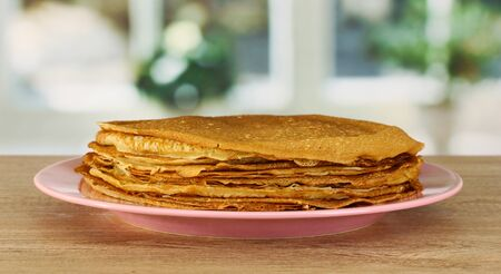 maslen: Sweet pancakes on plate on table in kitchen