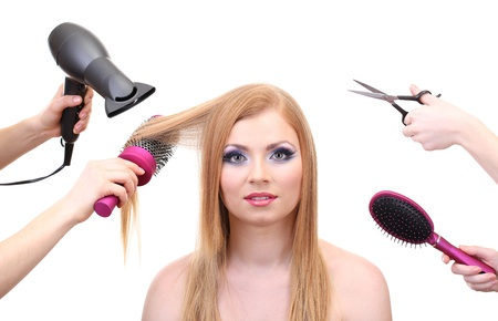 Beautiful woman and hands with brushes, scissors and hairdryer isolated on white Stock Photo - 21538031