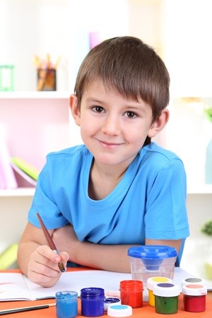 assiduous: Cute little boy painting in his album Stock Photo