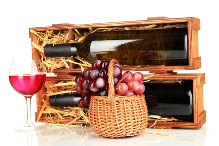 Wooden case with wine bottle, wineglass and grape isolated on white photo