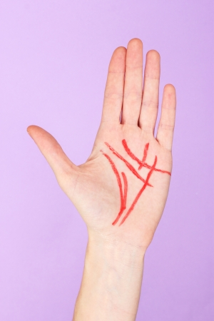 psychic reading: Chiromancy.Color contours on palm, on color background Stock Photo