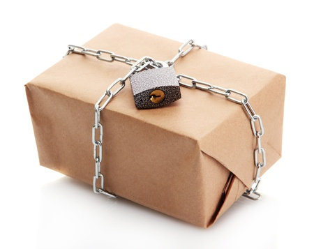 parcel with chain and padlock, isolated on white Stock Photo - 17595001