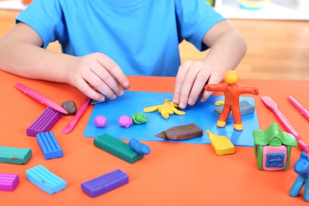 Child moulds from plasticine on table Stock Photo - 17596082