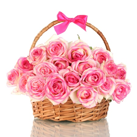 gift basket: beautiful bouquet of pink roses in basket, isolated on white Stock Photo