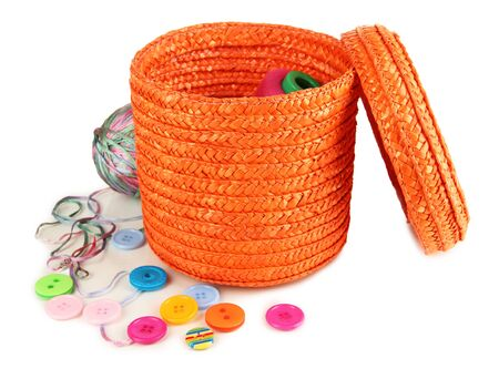 Orange wicker basket with accessories for needlework isolated on white Stock Photo - 17629033