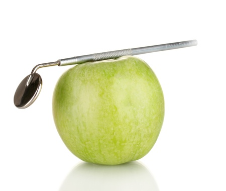 Green apple and dental tool isolated on white Stock Photo - 17629039