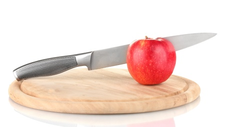 Red apple and knife on cutting board, isolated on white Stock Photo