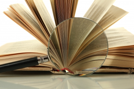 Magnifying glass and open book isolated on white Stock Photo - 17644368
