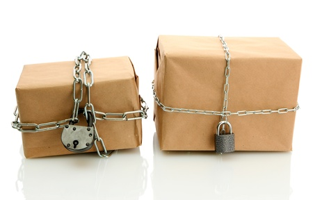 parcels with chains, isolated on white Stock Photo - 17629067