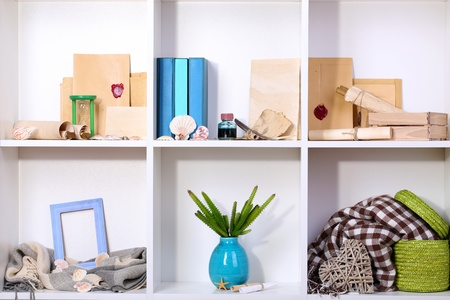 Beautiful white shelves with different travel related objects Stock Photo - 17644536