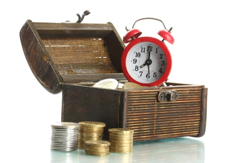 Alarm clock with coins in chest isolated on white Stock Photo - 17644133