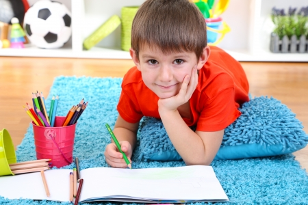 Cute little boy drawing in his album Stock Photo - 21538140