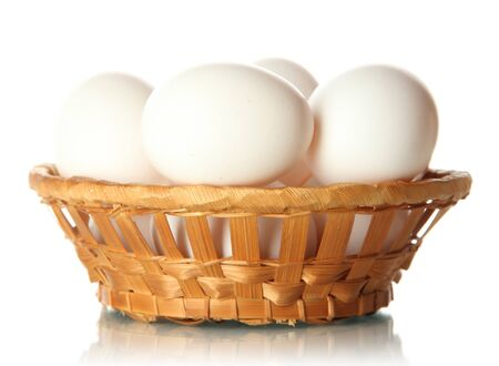Many eggs in basket isolated on white Stock Photo - 17644095