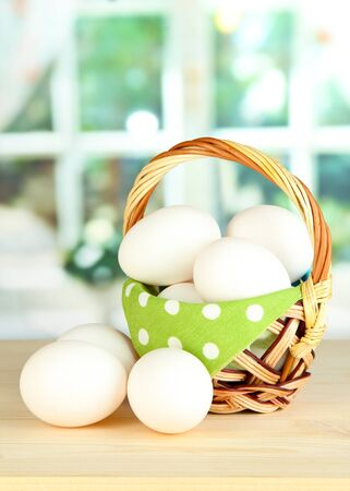 Many eggs in basket on table in room Stock Photo - 17644174