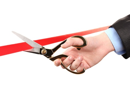 Cutting red ribbon, isolated on white Stock Photo - 17633566