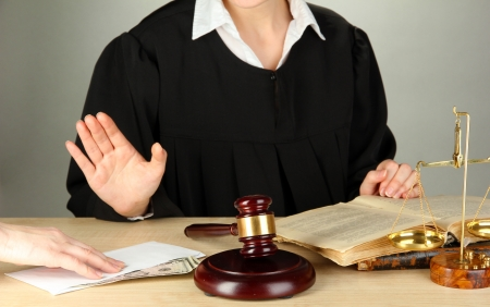 Judge sitting at table during court hearings on grey background Stock Photo - 17633590