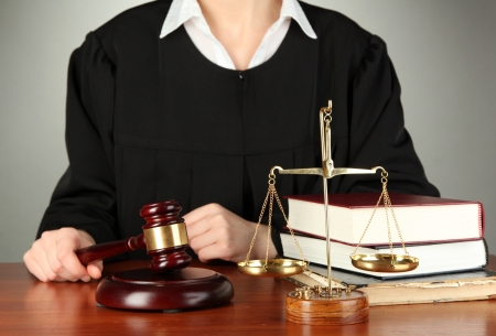 Judge sitting at table during court hearings on grey background Stock Photo - 17633586