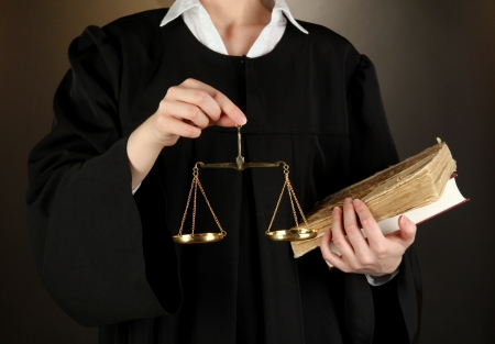Judge on black background Stock Photo
