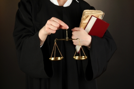 golden rule: Judge on black background Stock Photo