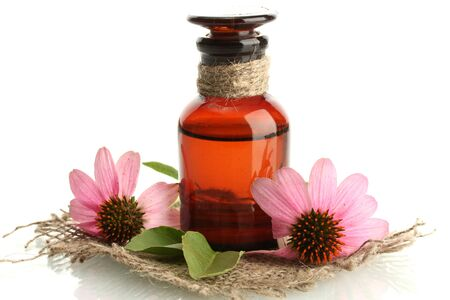 medicine bottle with purple echinacea , isolated on white photo