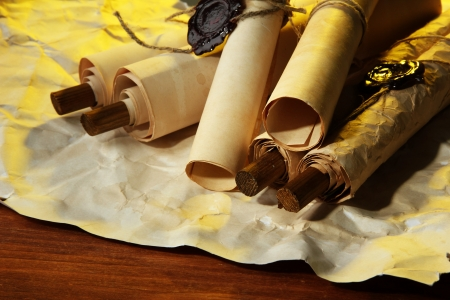 Old scrolls, on brown paper background Stock Photo - 17634084