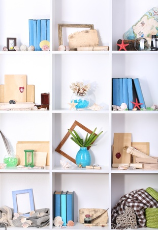 Beautiful white shelves with different travel related objects Stock Photo - 17634094